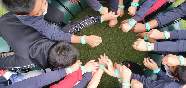Children in Tower Hamlets in London with their Moki bands