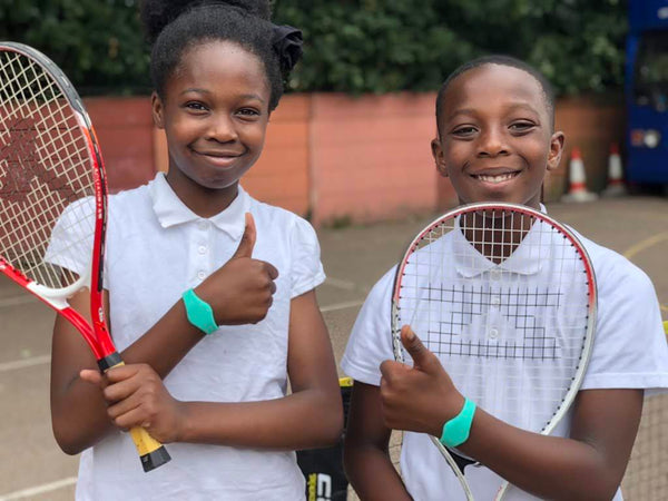 Children at St. Fidelis School in London wearing Moki bands