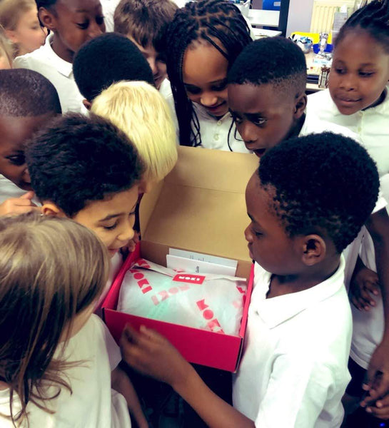 A class at St. Fidelis school unboxing Moki