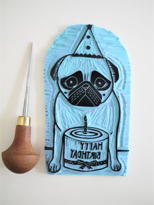 birthday pug lino carving