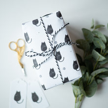 Black cat gift wrapped present