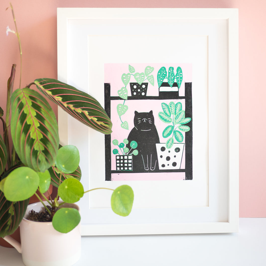 Black cat houseplant lino print