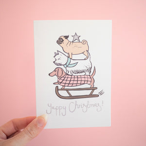 yappy christmas dog lino print card in hand