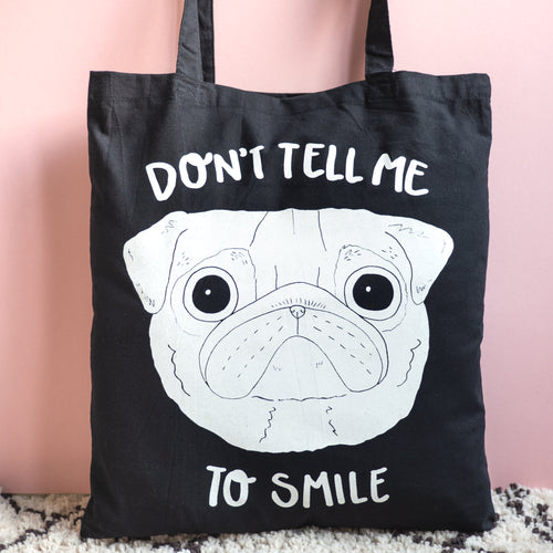 Don't tell me to smile feminist pug tote bag