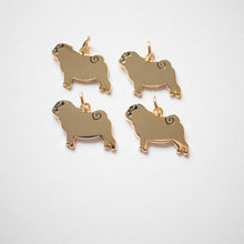 Group of gold pug charms