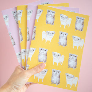pink and yellow pug print notebooks