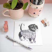 sausage dog in a jumper lino print card