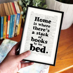 'Home is where there's a stack of books' Framed Book Page Print