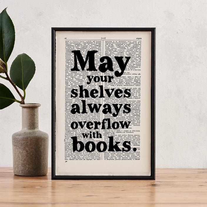 'May your shelves always overflow with books' Framed Book Page Print