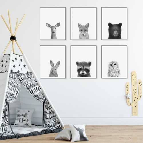 Six Framed Baby Animal Prints in Black & White in Kids Room With Tipi