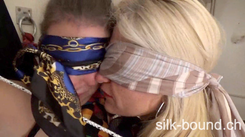 2 girls tied up on a cross - a wonderful combination of scarves and bondage