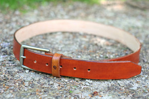 Hand stitched leather and metal belt buckle