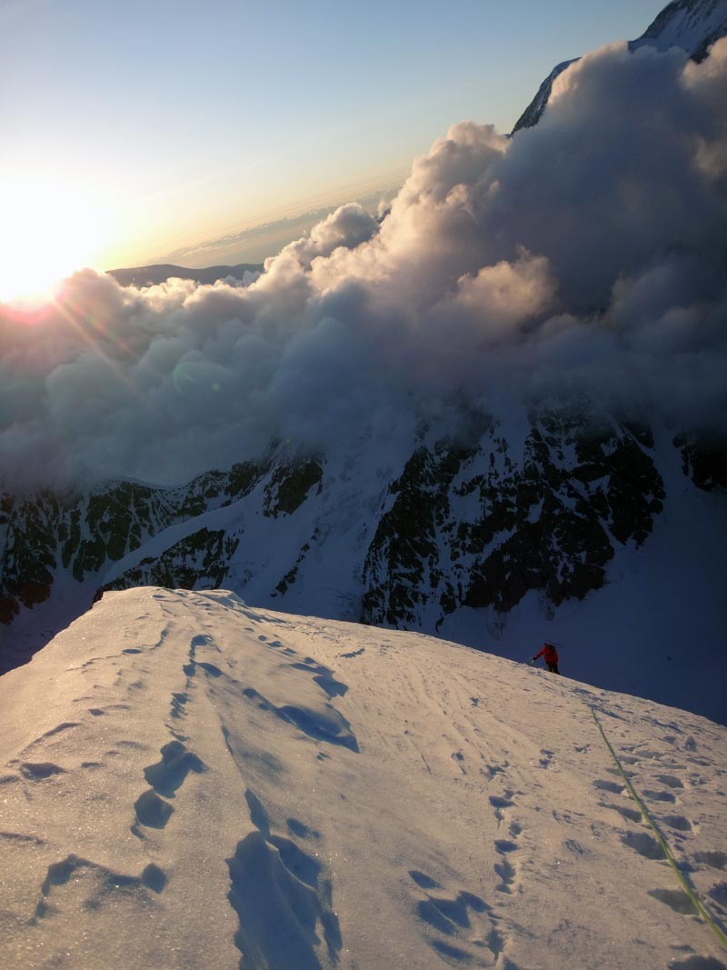 """""""Intimidating clouds rolled in as we climbed the last third of the peak."""" -Kurt Ross   Photo by J.D. Merritt"""