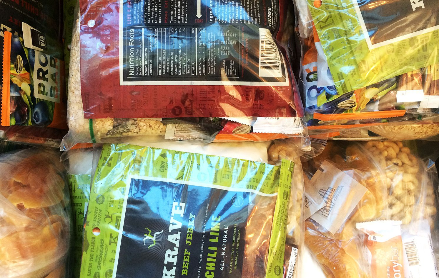 A photograph of an assorment of foods commonly used in ultralight backpacking recipes for extended hikes.