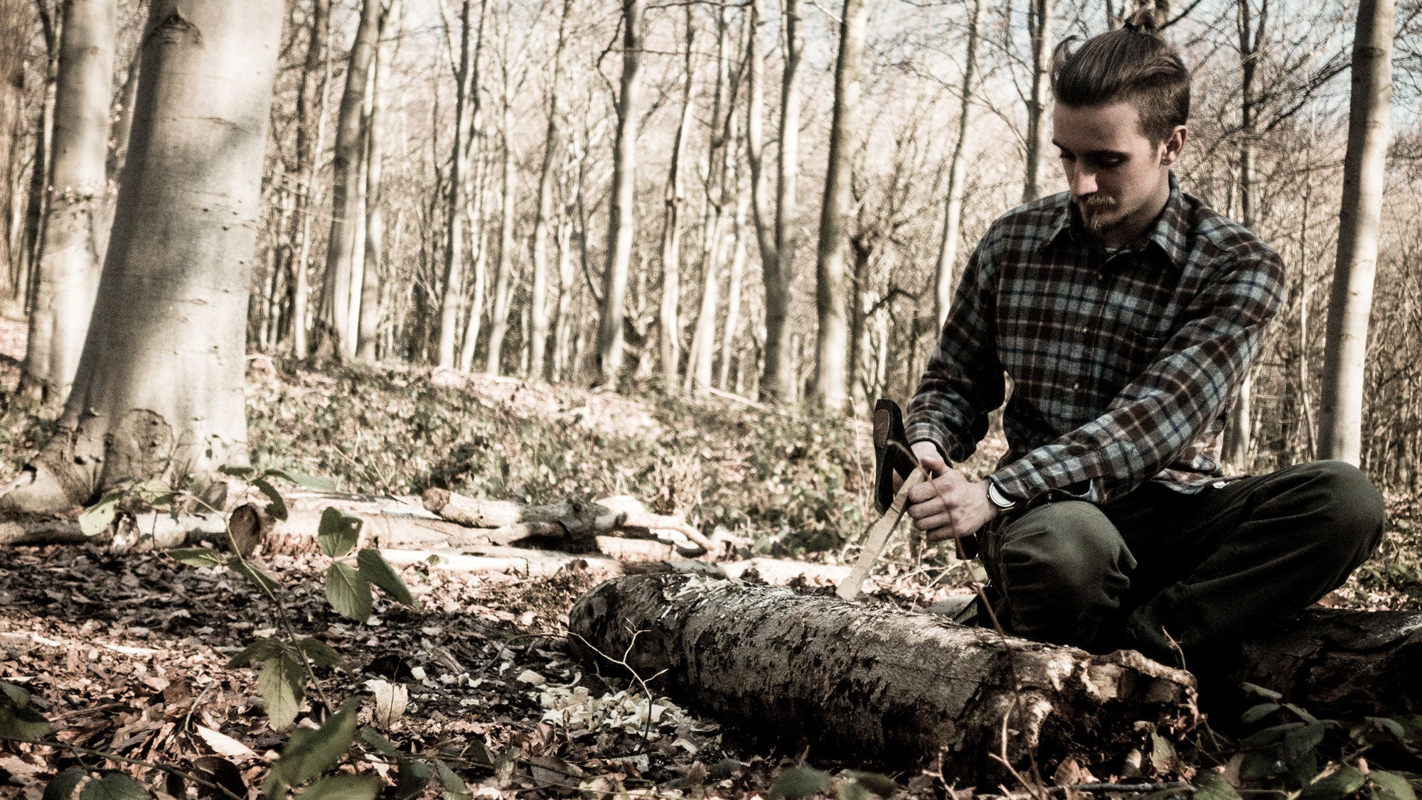 """""""Bushcraft is about thriving in the natural environment and the acquisition of the skills and knowledge to do so. Bushcraft skills include firecraft, tracking, hunting, fishing, shelter-building, the use of tools such as knives and axes, foraging, hand-carving wood, container construction from natural materials and rope and twine-making, among others."""" --Wikipedia"""