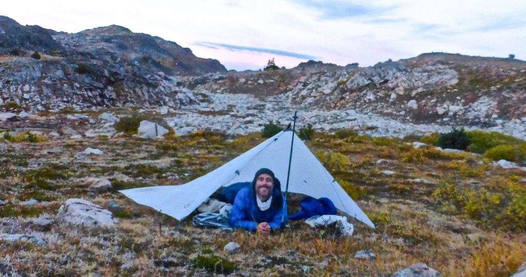 The morning after   All smiles after riding out a late summer storm in the Beartooth range   Montana, 2016.
