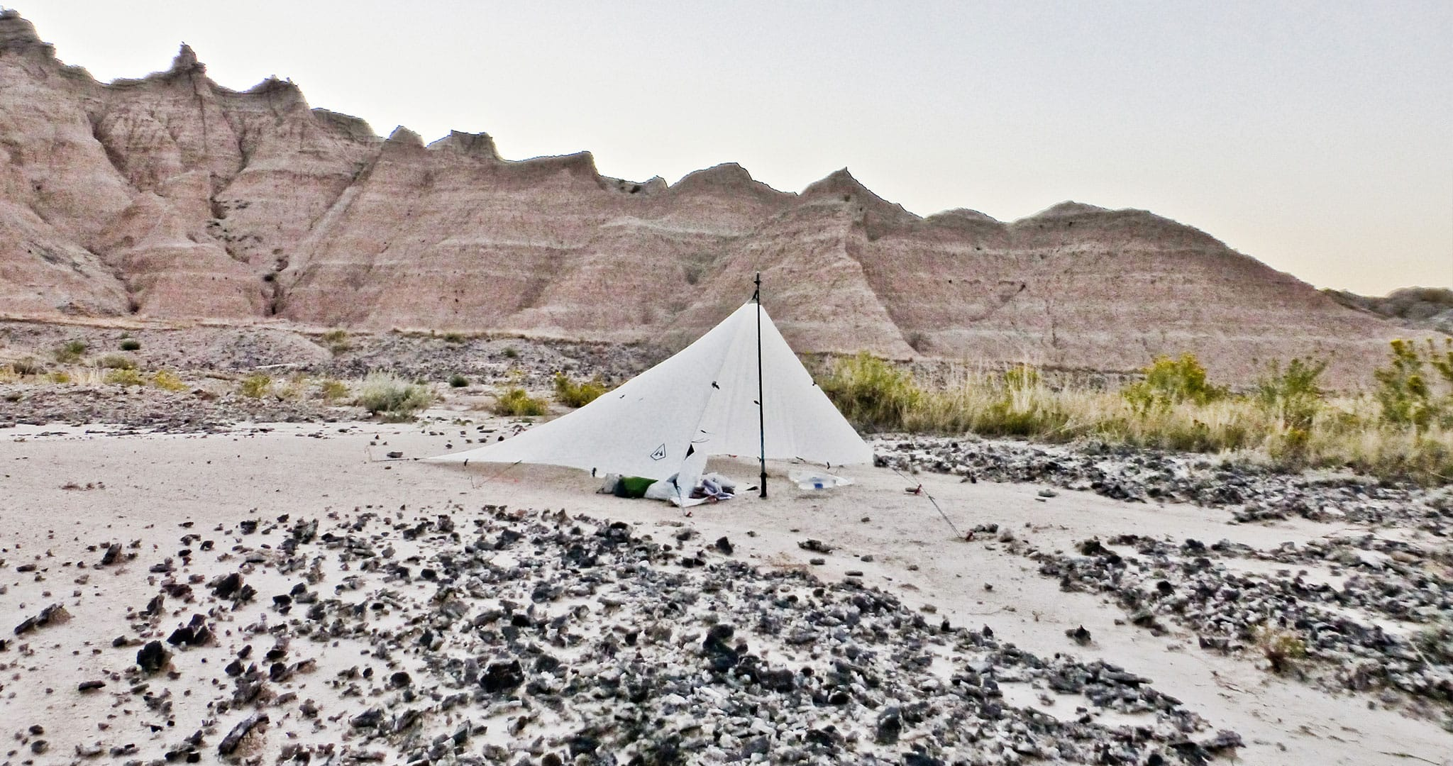 An ultralight backpacking tarp pitched for tarp camping in Badlands National Park | South Dakota, 2016.