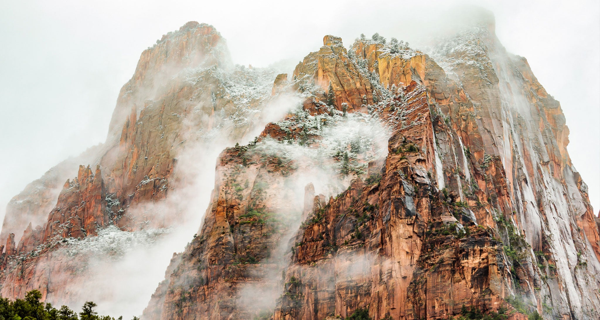 The featureless base of nimbostratus over Zion National Park in late May that resulted in an all night and near all day steady rain.  The ragged stratus clouds hugging the canyon walls are the result of evaporative cooling with air in contact with the canyon walls reaching saturation.  It is very common in lower latitudes such as southern Utah and in late spring for a steady prolonged rain in a stable atmosphere to transition into an unstable rain shower and cumulus cloud scenario caused by strong sun heating.