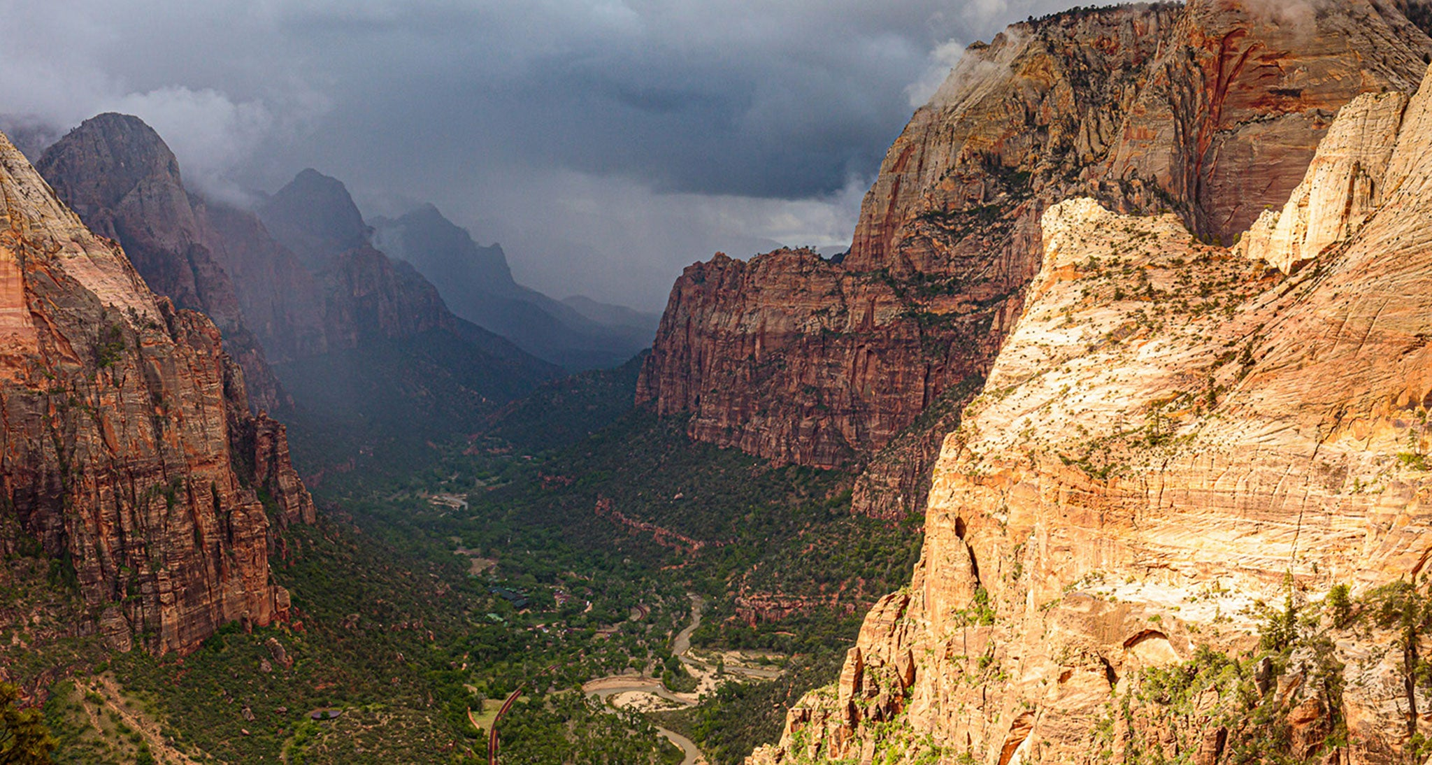 This is a rapidly developing GTFO situation on the summit of Angel's Landing in Zion National Park, Utah.  Looking south toward Zion Canyon entrance are the telltale signs of a cumulonimbus cloud-darkening bases, shafts of rain and the formation of ragged low clouds beneath the base that signify strong evaporative cooling. Significant low level moisture remained over the area left  from an all night rain from nimbostratus.  A little daily heating set the stage for thunderstorm development as the atmosphere transitioned from stable to unstable.  This thunderstorm did not move over us but expended and built over us so we were under one massive cell.  We got off the summit in time to avert exposure to lightning and heavy rain.  Slow moving cells with very light steering flow aloft can be quite dangerous as they unload their moisture over a very concentrated area vs moving through your location.