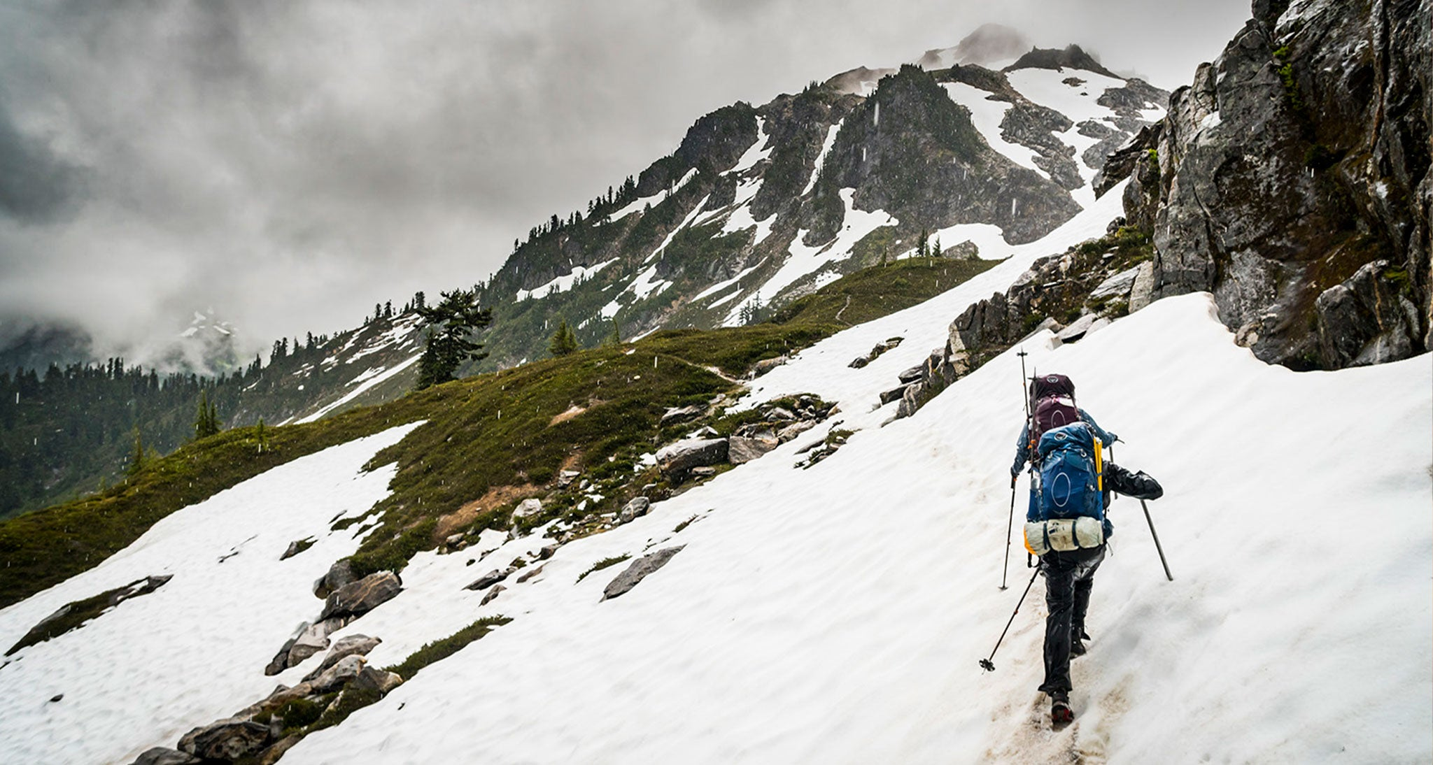 Dicey Call.  Southbound Pacific Crest Trail hikers ascend  Fire Creek Pass in July in the Glacier Peak Wilderness in the Washington Cascades.  Precipitation from cumulus is a cold rain process.  Even in summer, precipitation from cumulus cells starts as snow that melts to rain in the column of warm air below.  At high elevation, 6000' here, all the precipitation fell as snow even in the 3rd week of July.   Evaporative cooling from large cumulus cells can be strong enough to drop temperatures 15-20 degrees in a 1000'.  An hour before crossing this pass we were in shorts and T-shirts.  When reaching the pass, evaporative cooling created a stratus cloud and was accompanied by strong winds funneling through the pass to where the trail was totally lost in the snow with visibility of around 100'.  Had it not been for navigational skills we could have been lost for a period of time in a dangerous hypothermic environment.