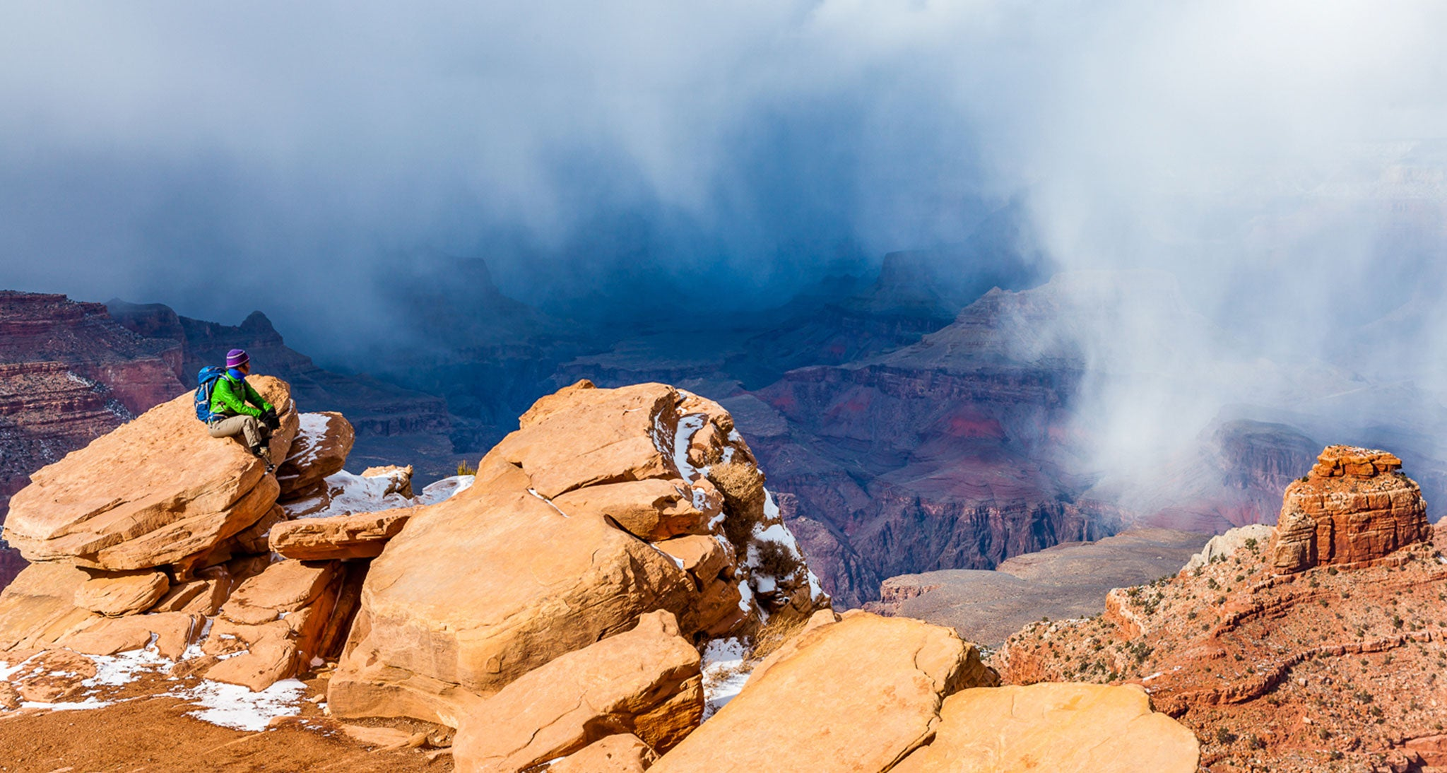 Cumulus clouds develop in the winter too as seen here over the Grand Canyon on the South Kaibab Trail.  This large cell is producing snowshoers seen by the white ragged shafts.  The cellular nature of the cloud base and the fact that snow started and stopped pretty abruptly several times that day is characteristic of cumulus clouds and showery precipitation.