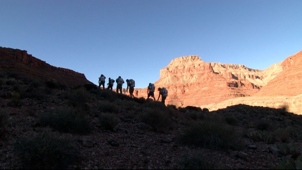 Group of teens in the Grand Canyon.