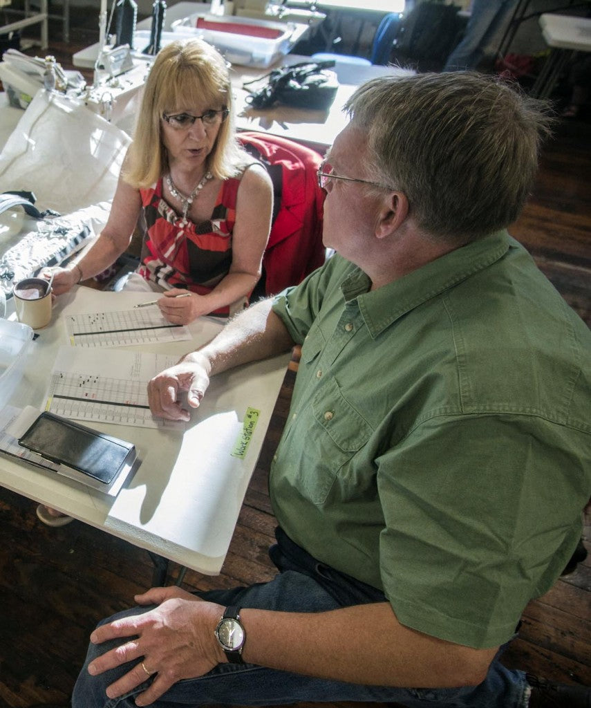 JoAnn Proulx, one of the company's most experienced stitchers, talks business with John Schafer.