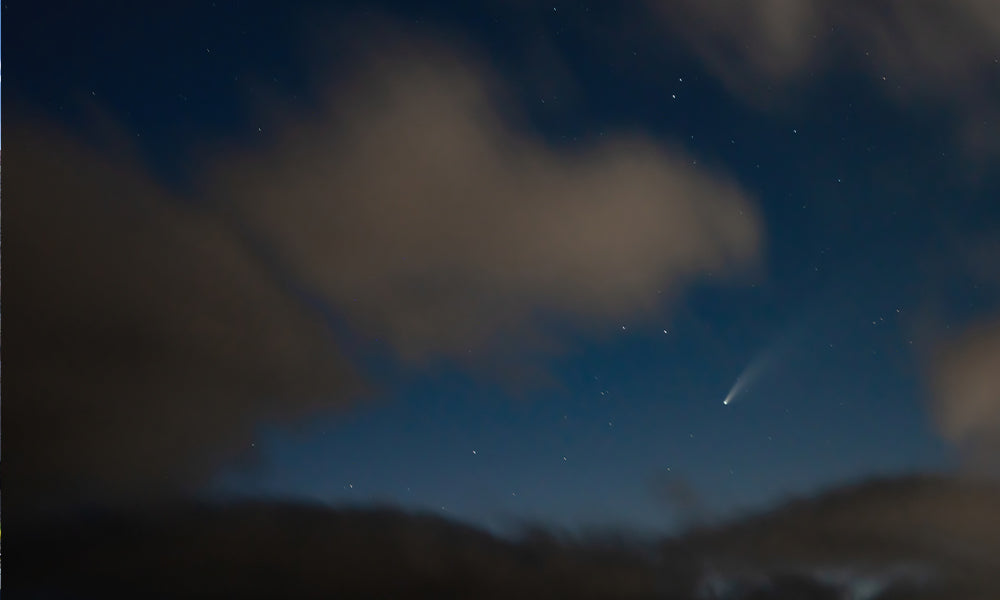 The Neowise Comet, quickly poking through the clouds.