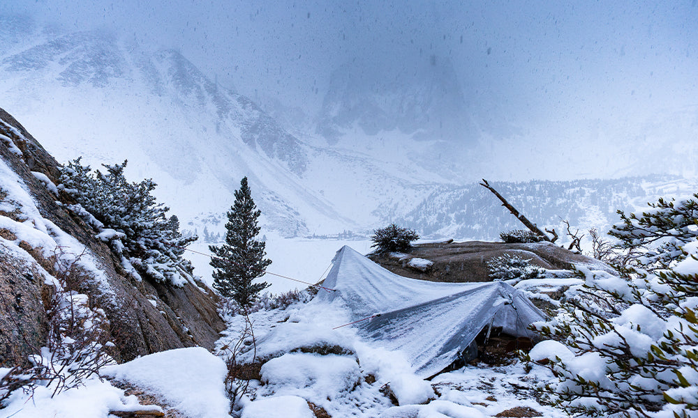 Camping on the way to the Palisades Glacier in a snowstorm.