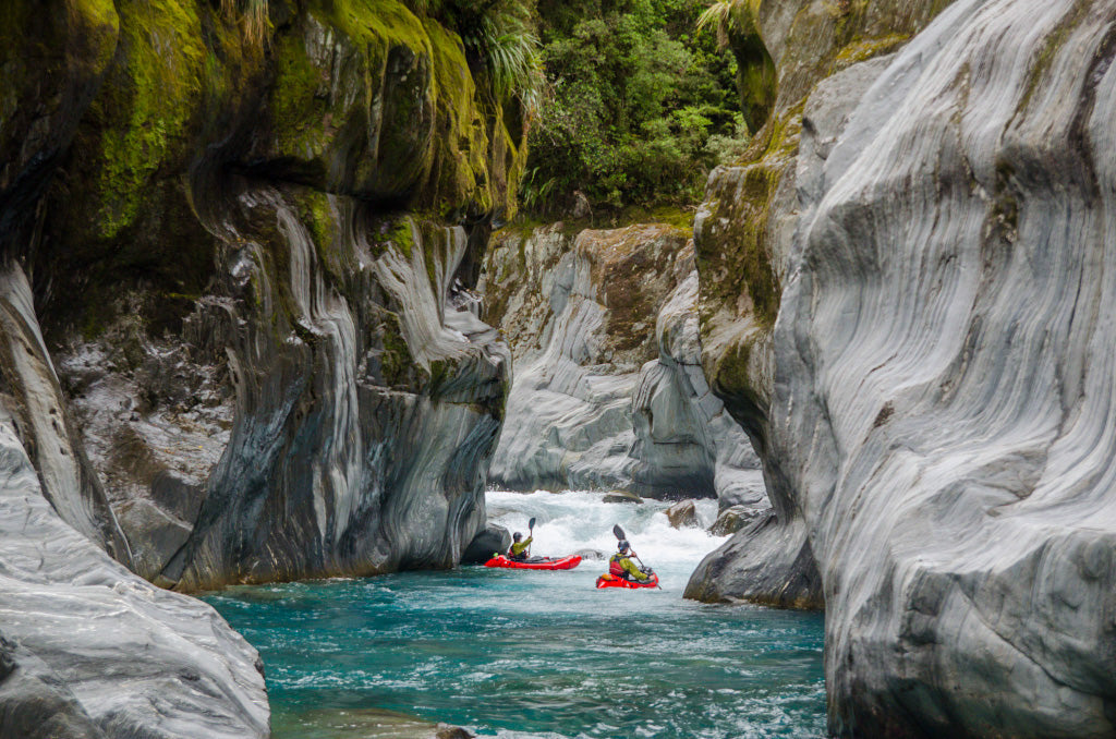 Two boaters packrafting New Zealand's Arahura River.