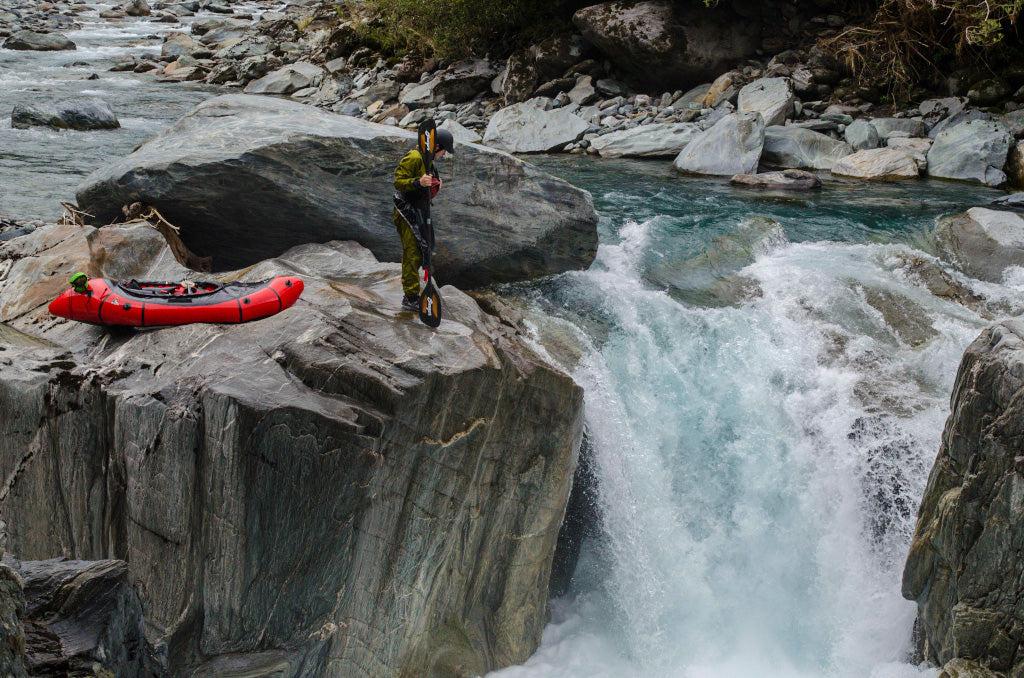Checking out the drop while packrafting in New Zealand.