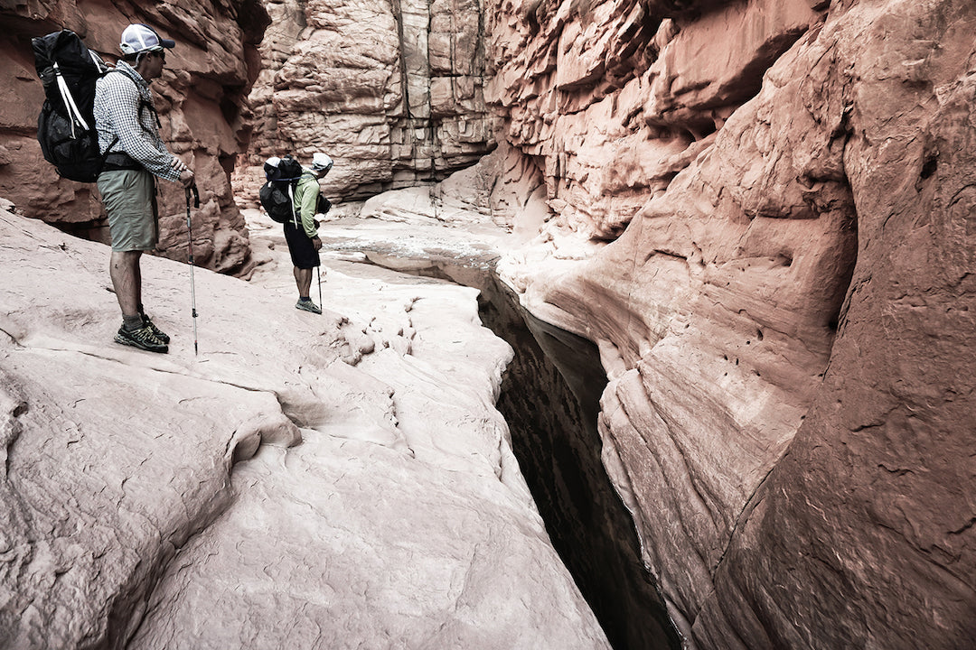 Kevin Fedarko and Peter McBride in the cool narrows of Rider Canyon.