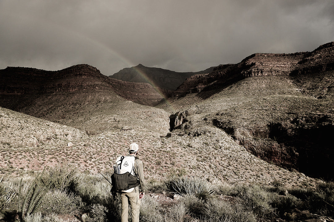 Chris Atwood gets a rainbow bonus after rain in Spring Canyon.