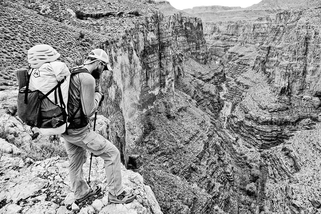 Chris Atwood looks for a way to cross the formidable Surprise Canyon.