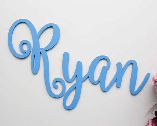 Nursery name sign in whimsical font style painted