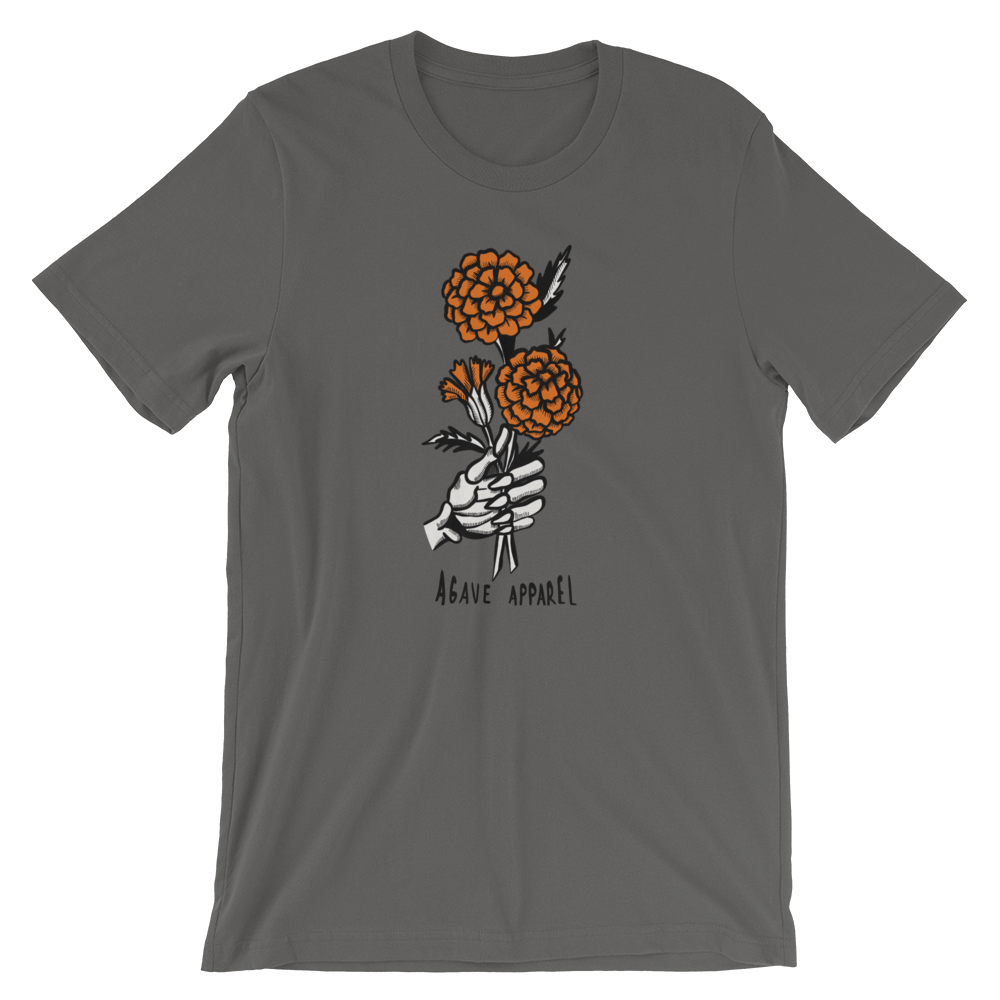 grey t-shirt with marigold bouquet held by a skeleton hand