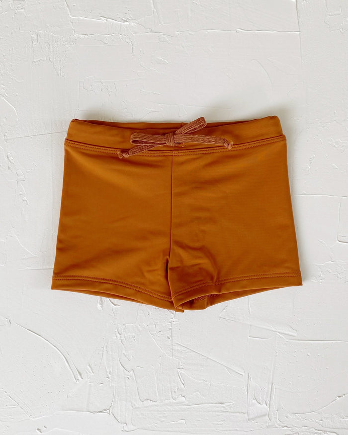 Little june park boy euro swim shorts in bronze