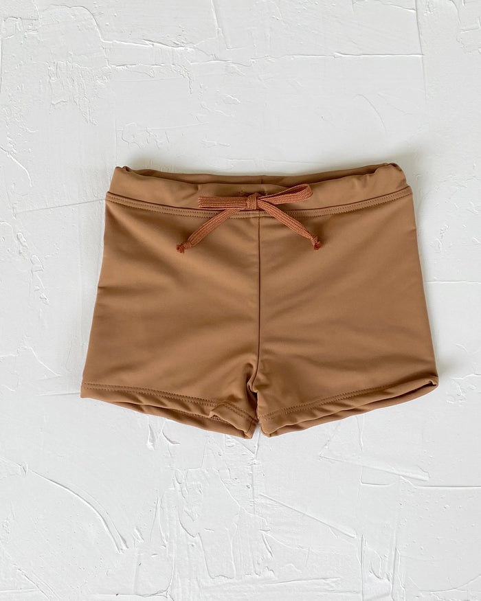 Little june park boy euro swim shorts in tanlines
