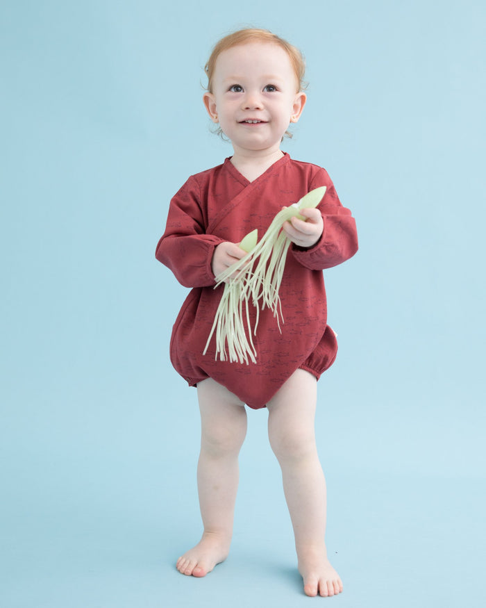 Little red caribou baby girl schooling fish woven onesie in rosewood