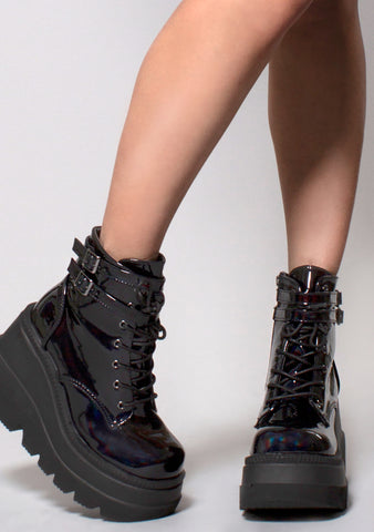 Demonia Shaker Hologram Platform Boots in Black