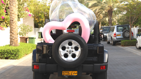 LOTELI Heart Pool Floats in a Jeep
