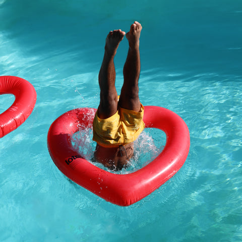 Guy diving into Red Heart Float