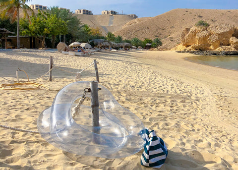 Clear Pool Floats on the Beach