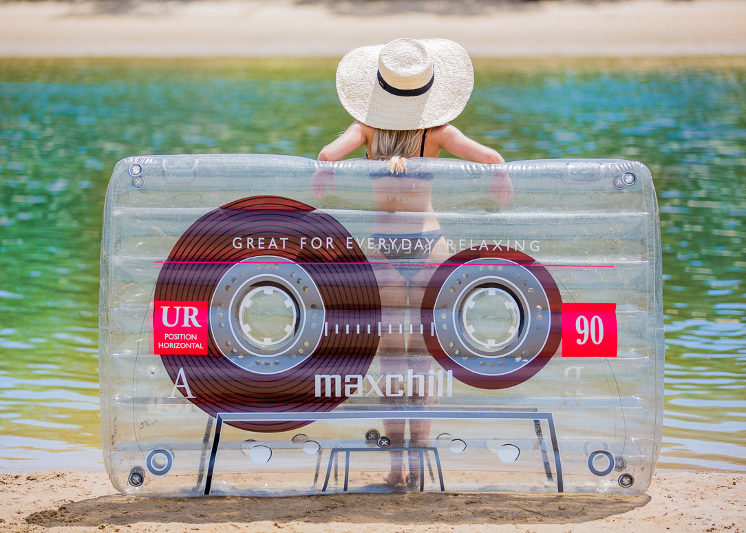 Girl with Loteli Cassette Float and Hat