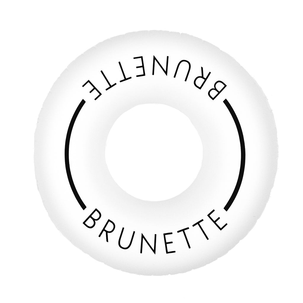 Aerial photo of white pool swim ring with the word brunette on it with a white background.