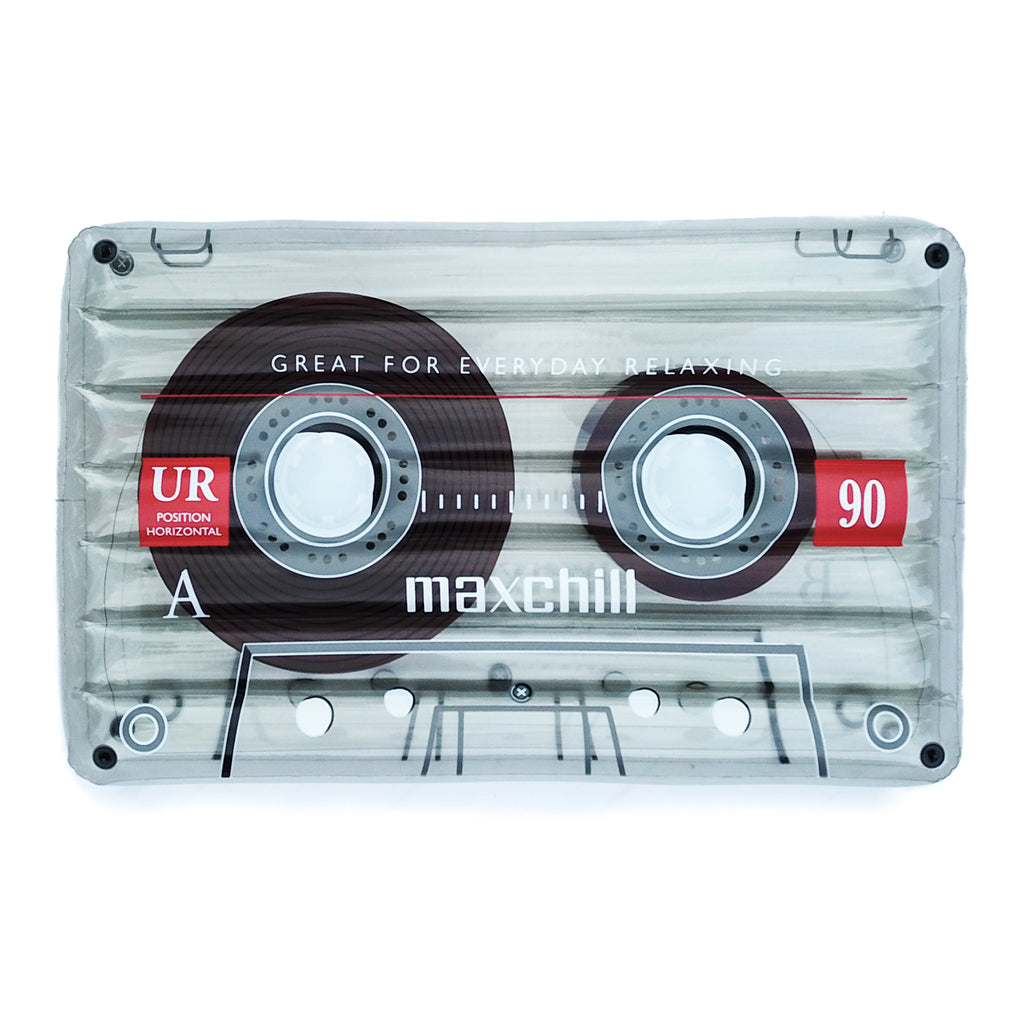 "Detailed photo of the clear cassette tape float in front of a white background. The float has the words ""Great for everyday relaxing"" and the mimicked logo of ""Maxchill."""
