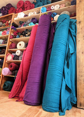 Studio Picture: Yana Dee Custom Color Hemp Fleece Fabric Bolts in Red, Purple, and Teal