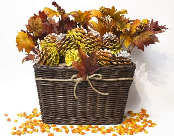 wicker basket arrangement with fall pinecones and greenery
