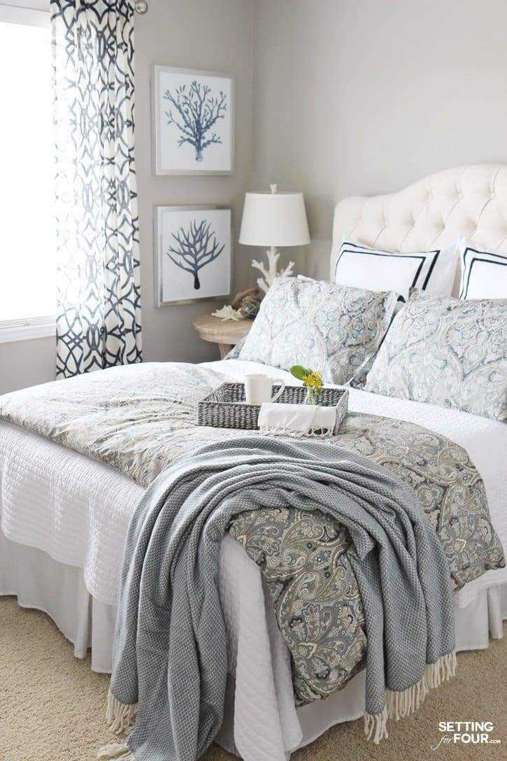 decorated light blue farmhouse bedroom