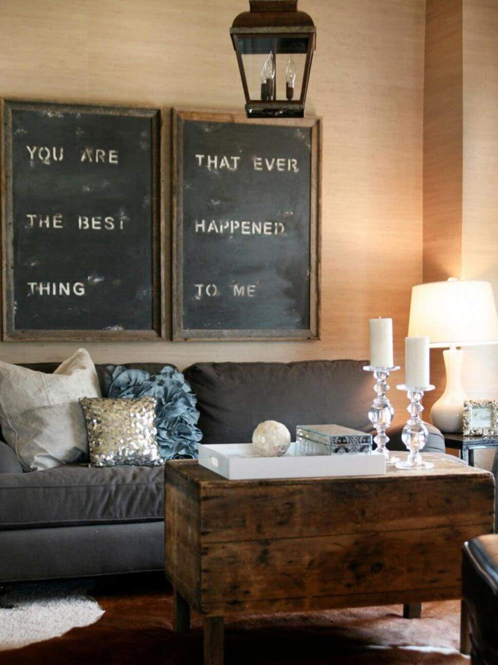 Get creative, why not stencil a message that has meaning to you on an old chalkboard? In this case the decorator used large rustic frames to bring your attention to the message on the signs. The chalkboard background gives this sign a rustic feel while it maintains an elegant quality to the room decor.
